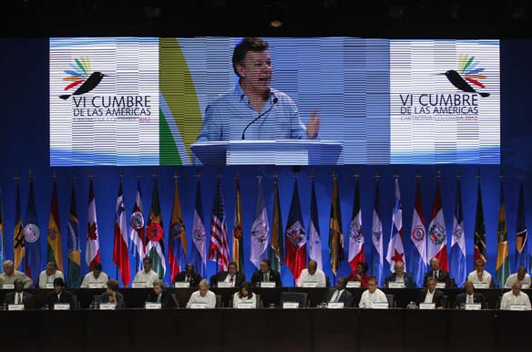 Colombia's President Juan Manuel Santos is projected live on a screen as he speaks in Cartagena
