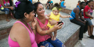 A family in Camag¸ey uses a Wi-Fi hotspot in a public plaza to let a baby girl talk with her father. Saturday June 25, 2016.